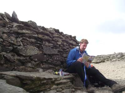 Sitting at the top of Helvellyn deciding where to go next